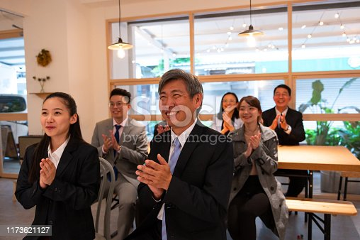 istock Professionals applauding in conference meeting 1173621127