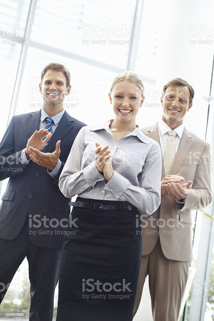 Professionals applauding royalty-free stock photo