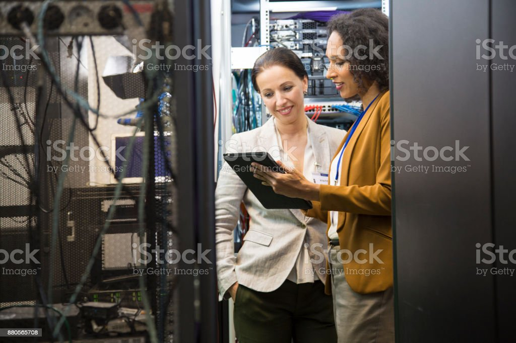 IT professionals having meeting in server room stock photo