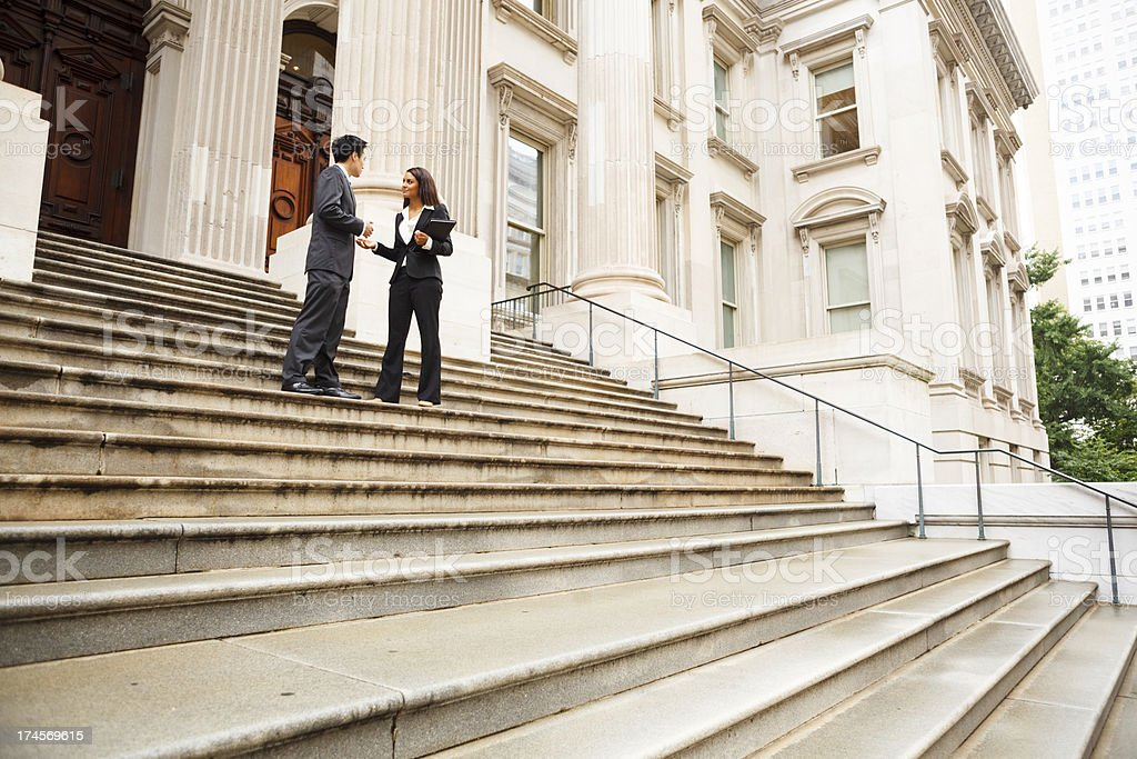 Professionals in Discussion on Staircase royalty-free stock photo