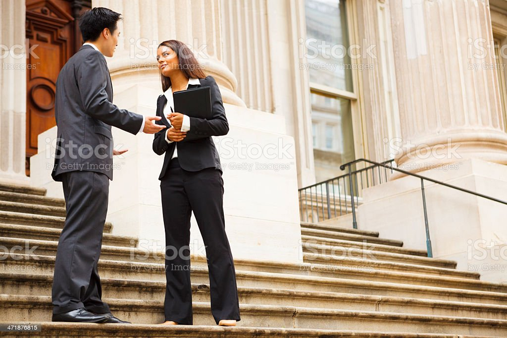 Professionals in Discussion Outdoors stock photo