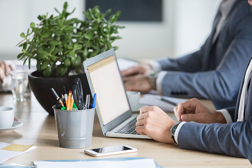 Professionals In Meeting Room With Laptop Stock Photo - Download Image Now
