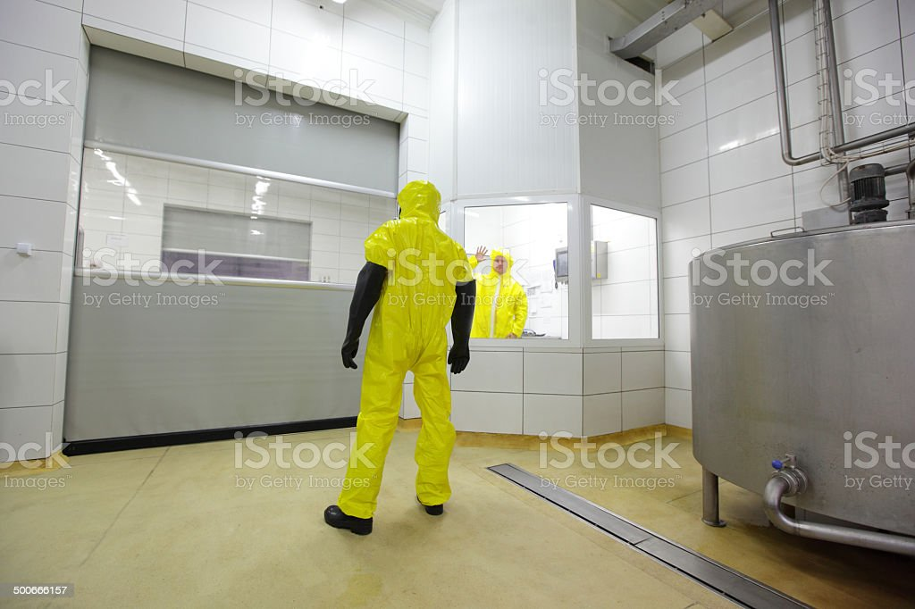 professionals in uniforms in modern plant stock photo