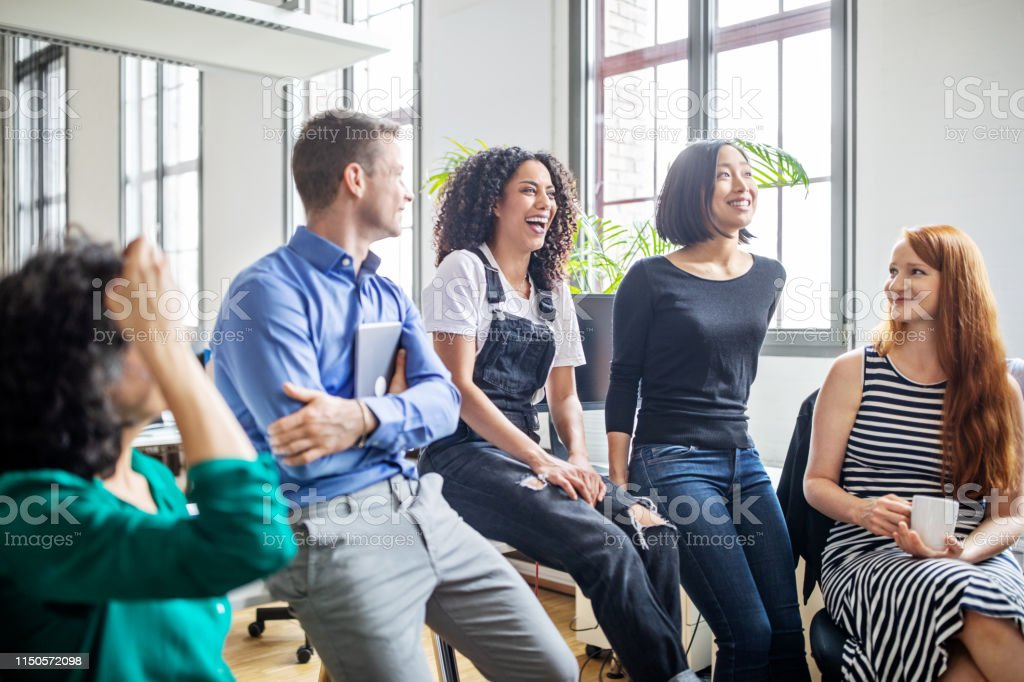Professionals laughing in a meeting - Royalty-free Adult Stock Photo