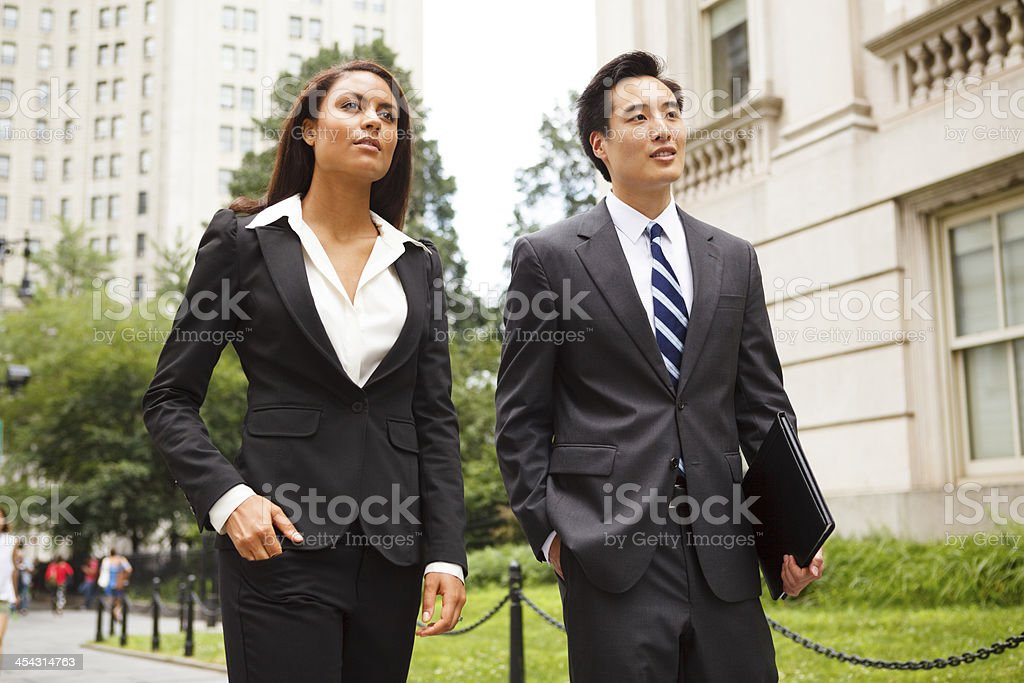 Professionals Walking Together Outdoors royalty-free stock photo