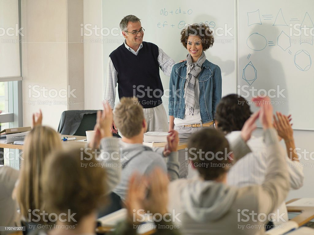 Professor and college student at front of classroom royalty-free stock photo