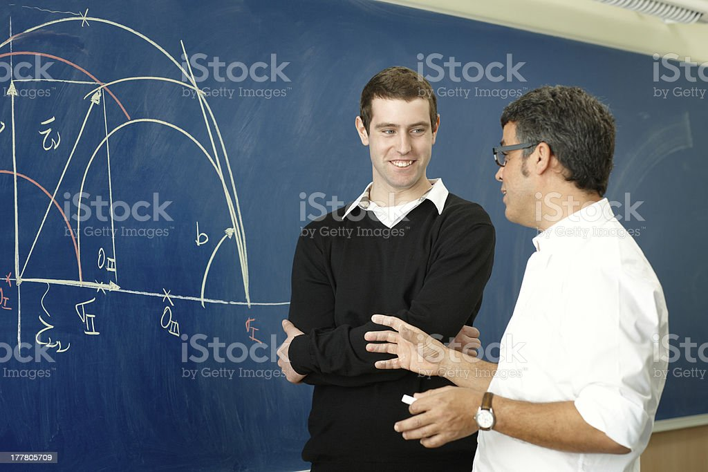 Professor and student in the classroom royalty-free stock photo
