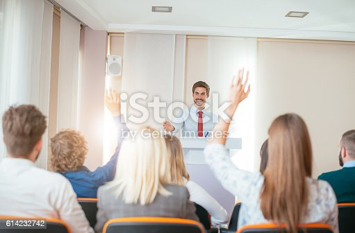 933450738 istock photo Professor assistant discussing global topics with students 614232742