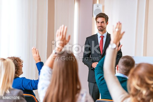 933450738 istock photo Professor assistant discussing global topics with students 639521076