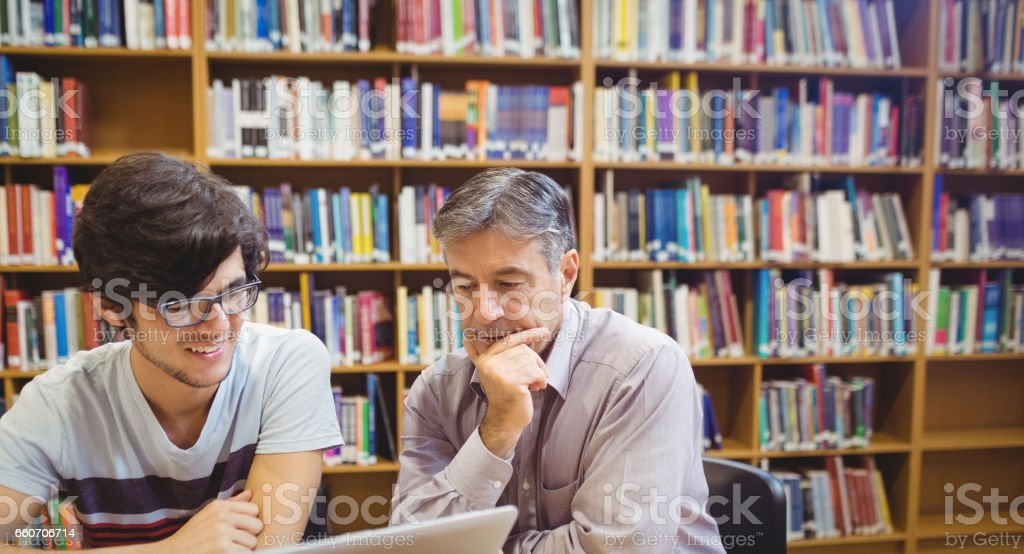 Professor assisting a student with studies stock photo