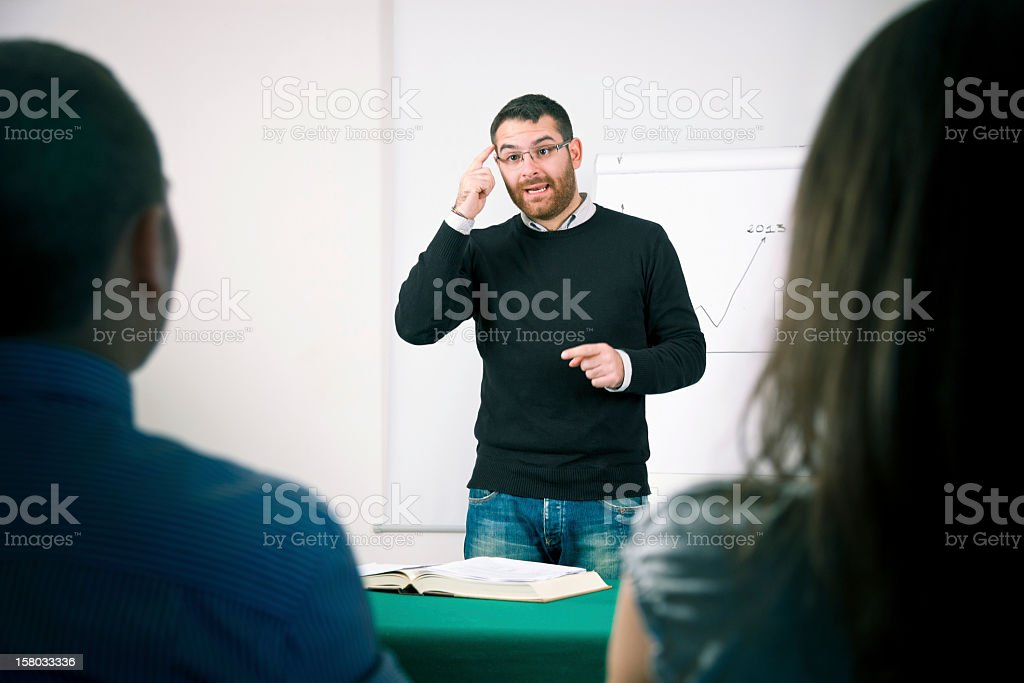 Professor explain a marketing lesson to students royalty-free stock photo