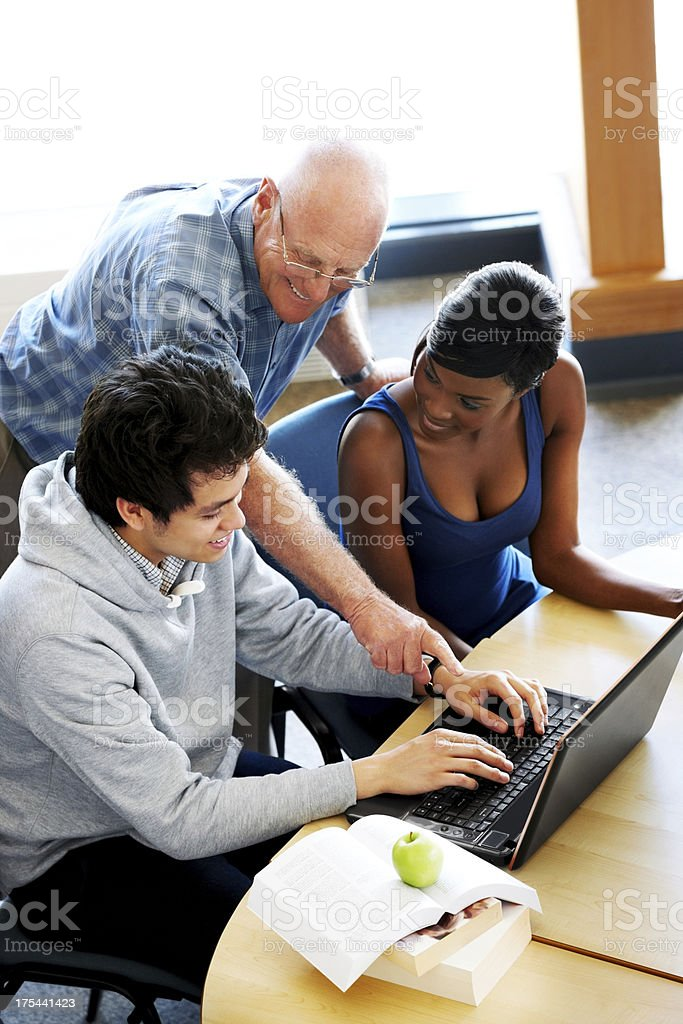 Professor giving instruction to students royalty-free stock photo