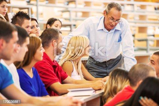 istock Professor helping a female student. 170036881