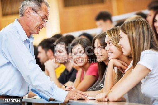 istock Professor helping a female student 171359784