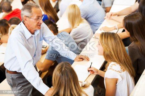 istock Professor helping a student 171351337