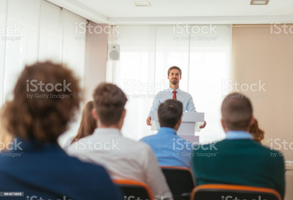 Professor in front of the students stock photo