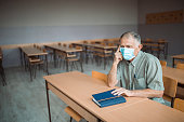 istock Professor is sad in an empty classroom because corona virus 1245365973