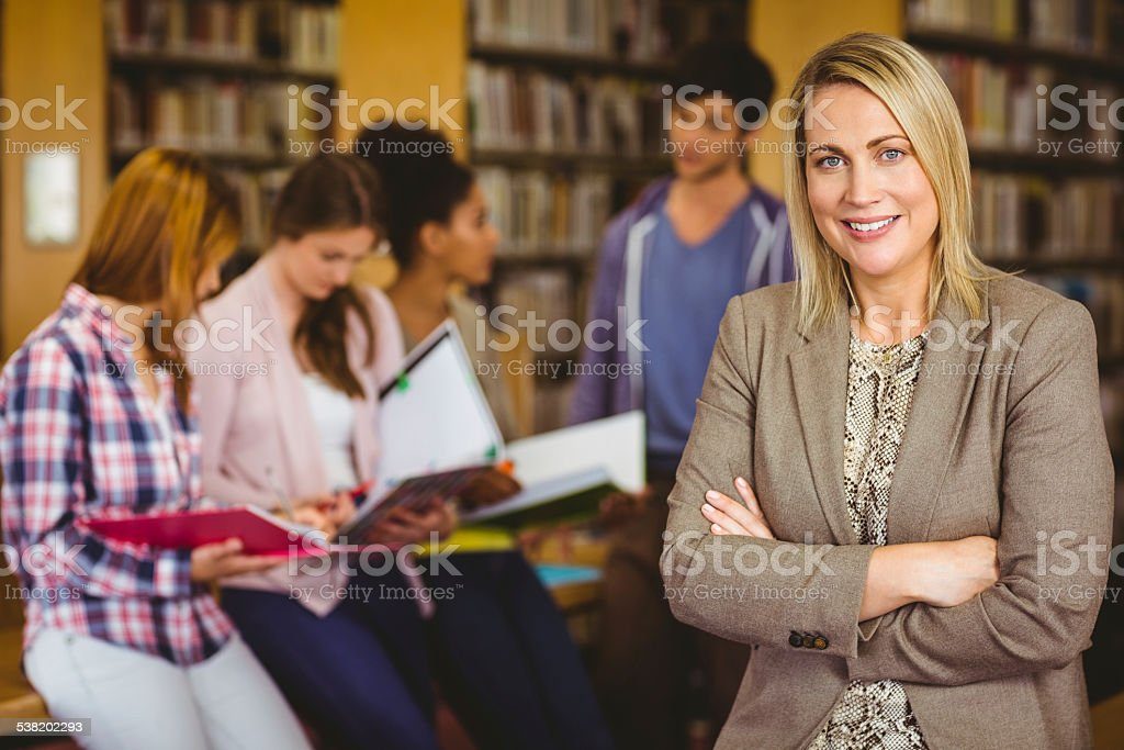 Professor looking at camera with arms folded stock photo