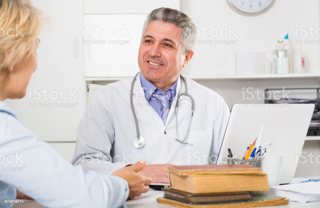 Professor of medicine training colleague royalty-free stock photo