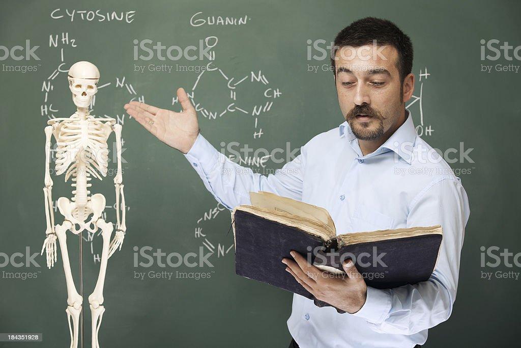 Professor Pointing Skeleton And Teaching Human Anatomy Stock Photo