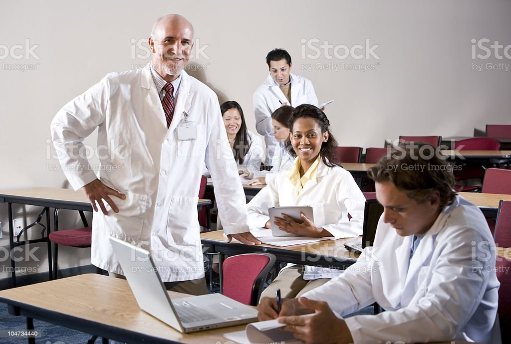 Professor with medical students in classroom royalty-free stock photo