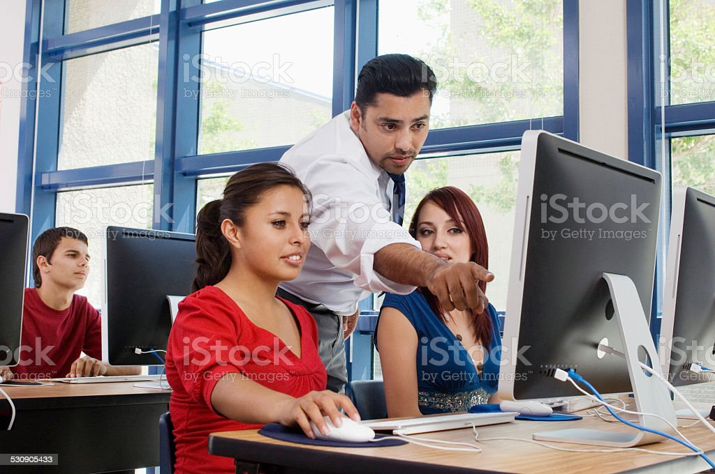 Professor With Students In Computer Class stock photo