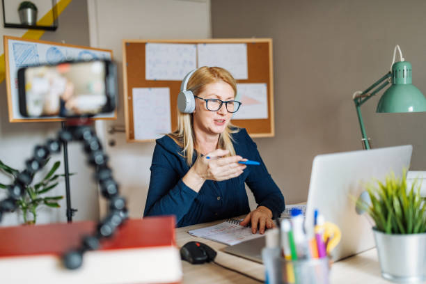 Professor working from home and using internet for online class with students stock photo