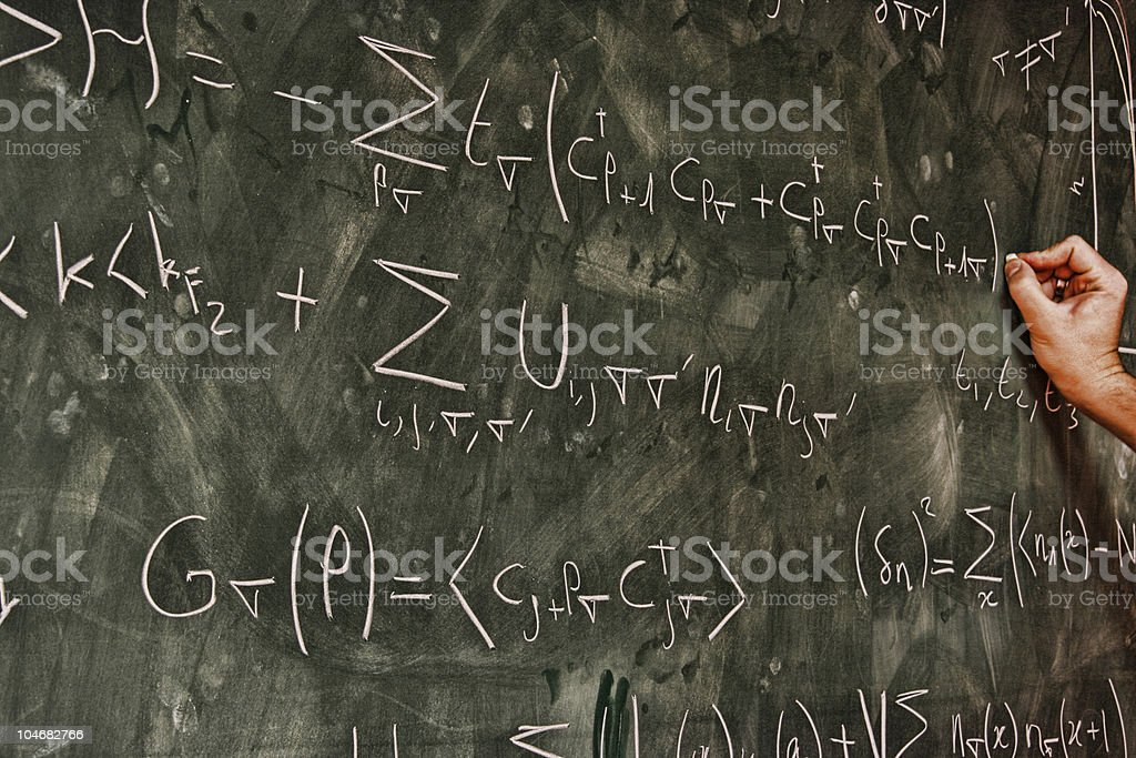 professor  writing equations on blackboard royalty-free stock photo