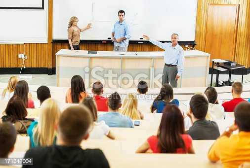 istock Professors and assistants giving a lecture. 171342004