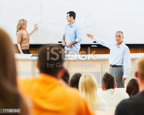 istock Professors and assistants giving a lecture 171352342
