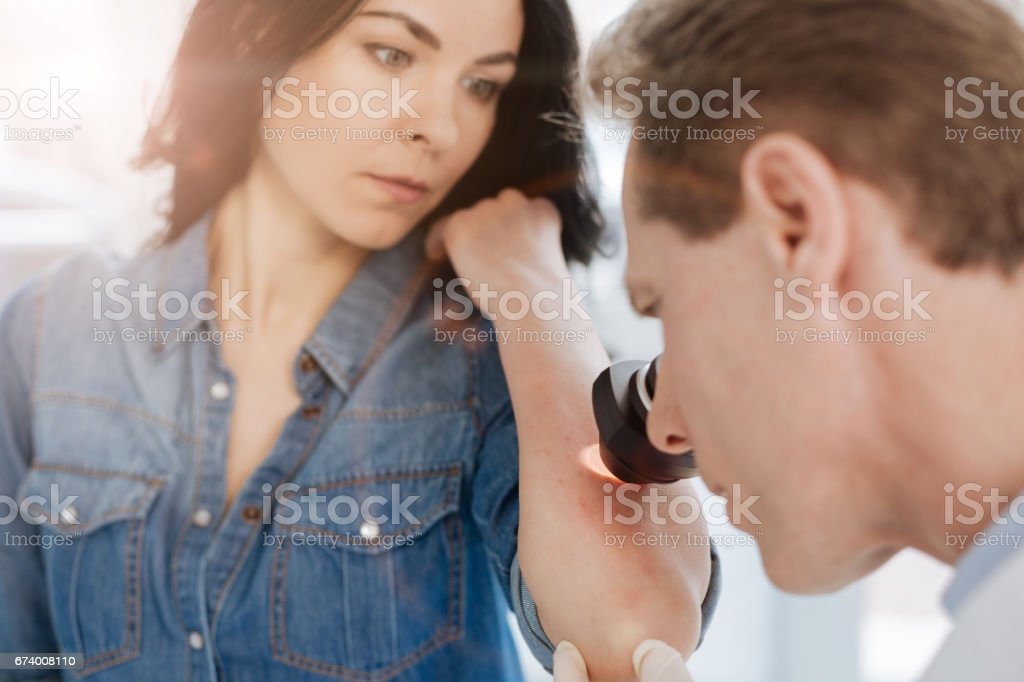 Proficient medical specialist examining allergy reaction examination at work royalty-free stock photo