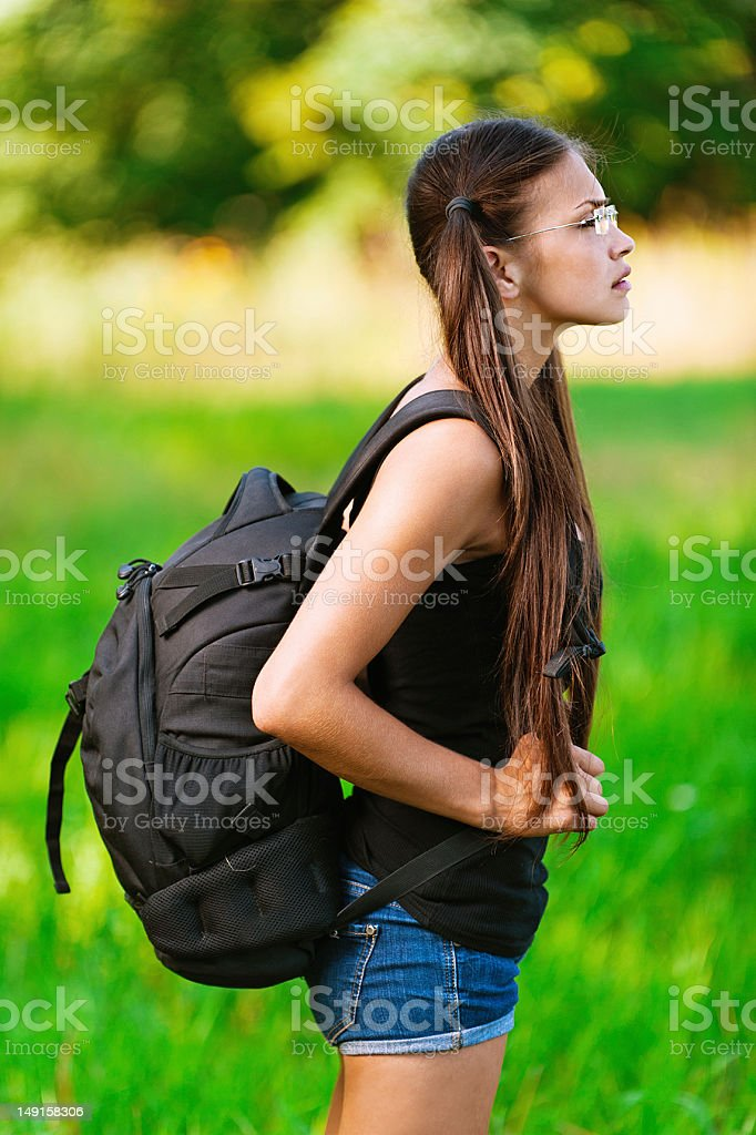 profile attractive woman glasses with backpack, stock photo