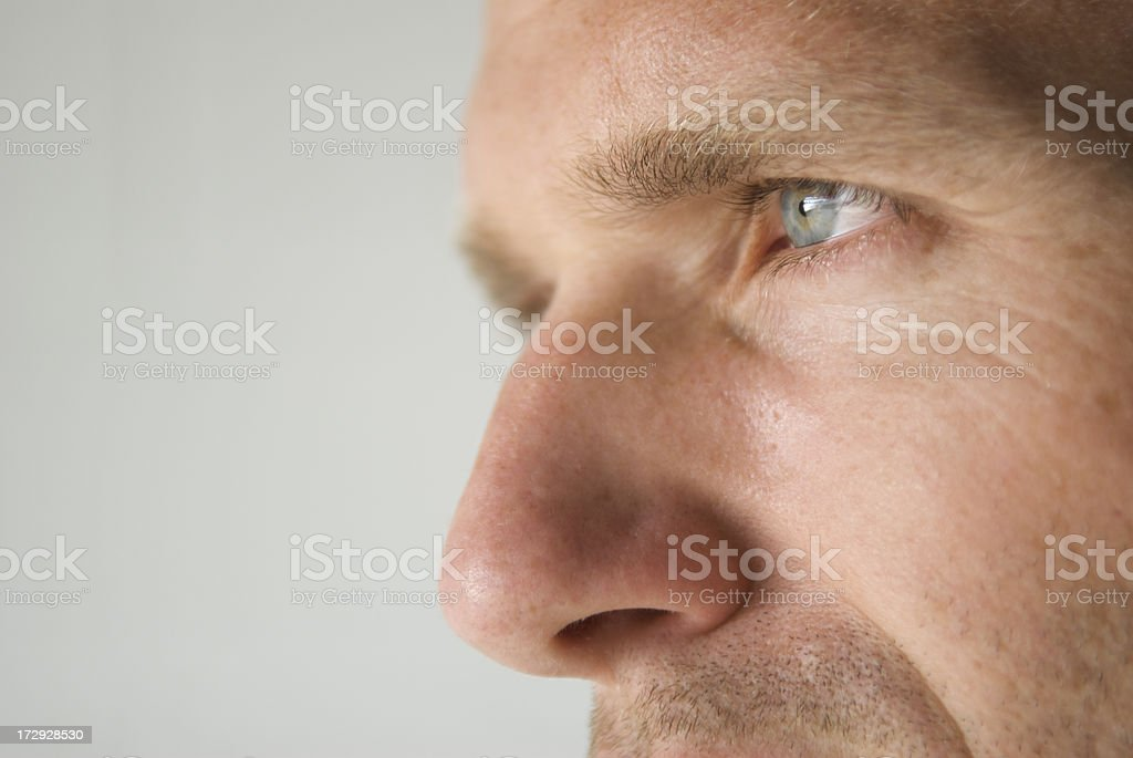 Profile Close-Up of a Man's Blue Eye and Prominent Nose stock photo