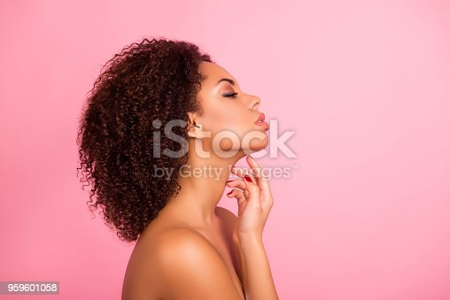 istock Profile, half face portrait of naked sensual, confident, attractive, brunette, charming, pretty enjoying her perfect skin with close eyes, touching her neck with fingers, isolated on pink background 959601058