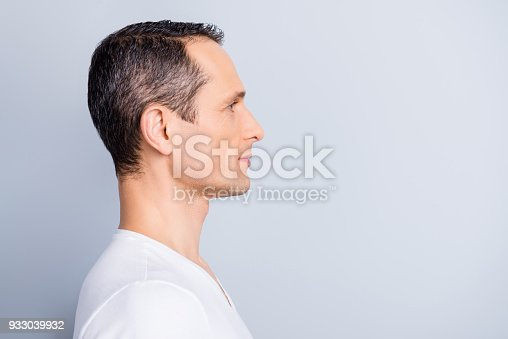 istock Profile, half face portrait with copy space of trendy, attractive, stylish, man looking at empty place for advertisement, product, having perfect ideal oiled, dry skin, isolated on grey background 933039932