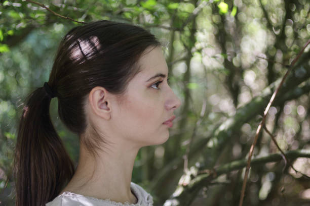 profile in woodland shade young beautiful bulgarian outdoor girl - whiteway english outdoor girl stock photos and pictures