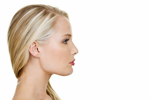 profile of a beautiful woman - profile view stock photos and pictures