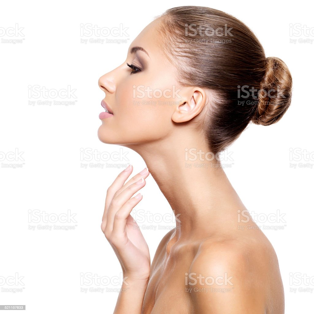 Profile of a beautiful woman with fresh clean skin stock photo