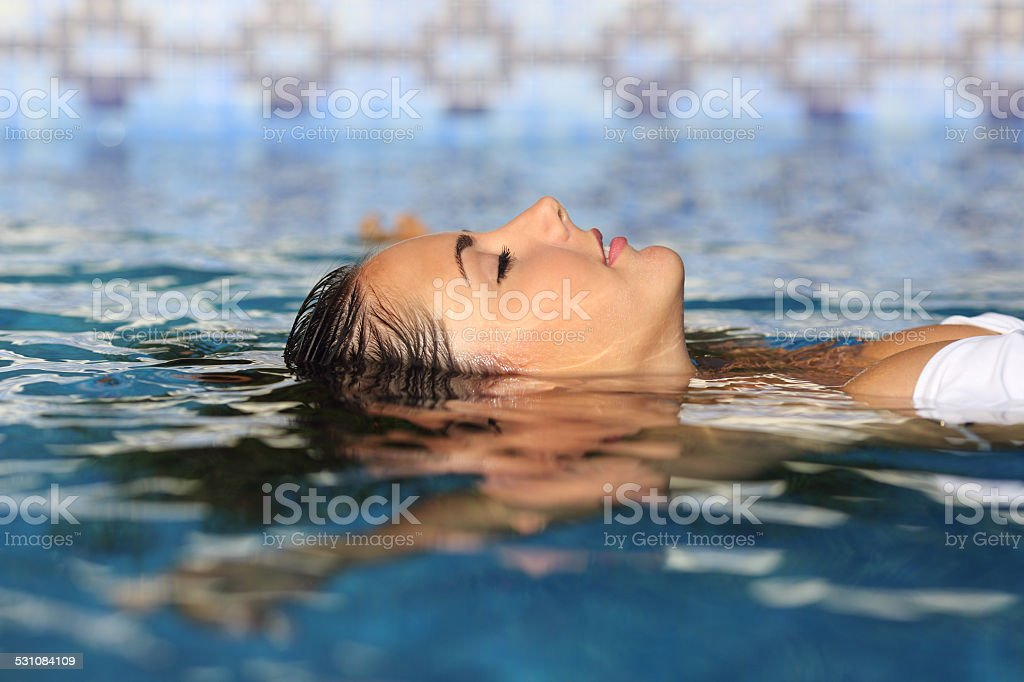 Profile of a beauty relaxed woman face floating in water stock photo