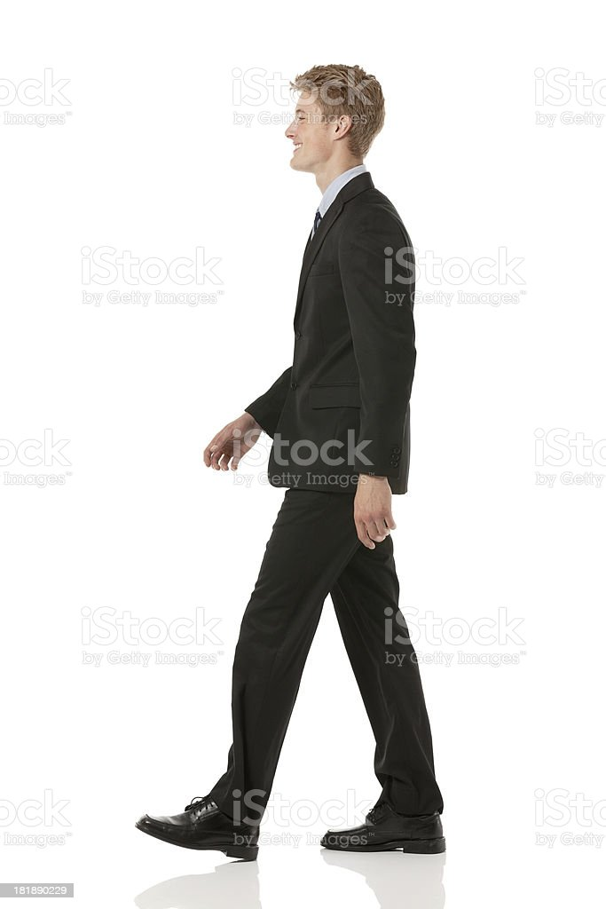 Profile of a businessman walking royalty-free stock photo