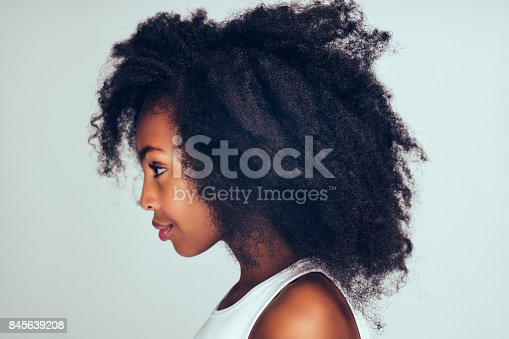 istock Profile of a cute little African girl with curly hair 845639208