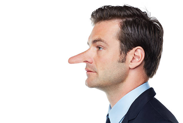Profile of a dishonest businessman Conceptual image of an unethical and dishonest executive looking towards copyspace human nose stock pictures, royalty-free photos & images