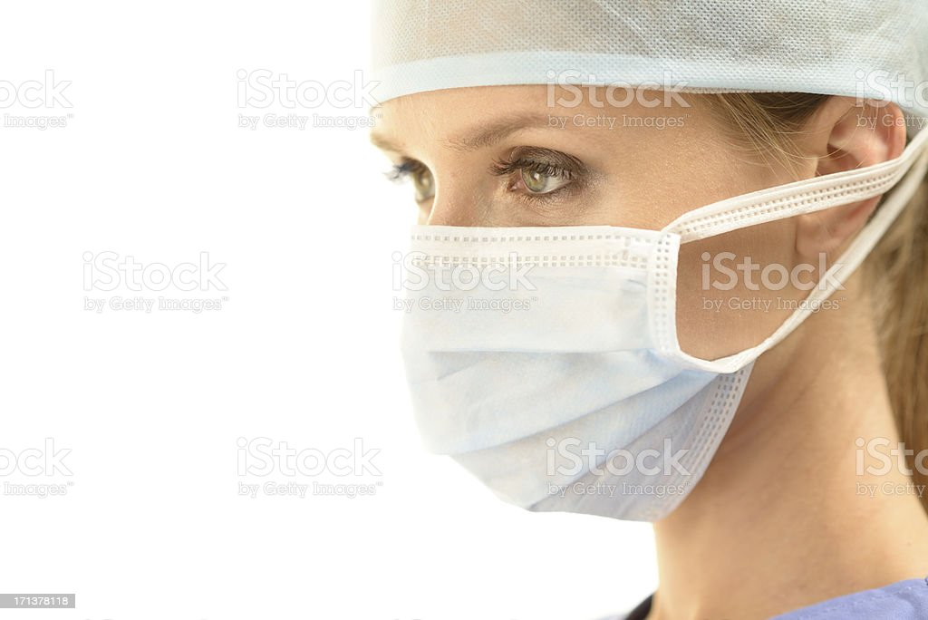Profile of a female surgeon in operation room royalty-free stock photo