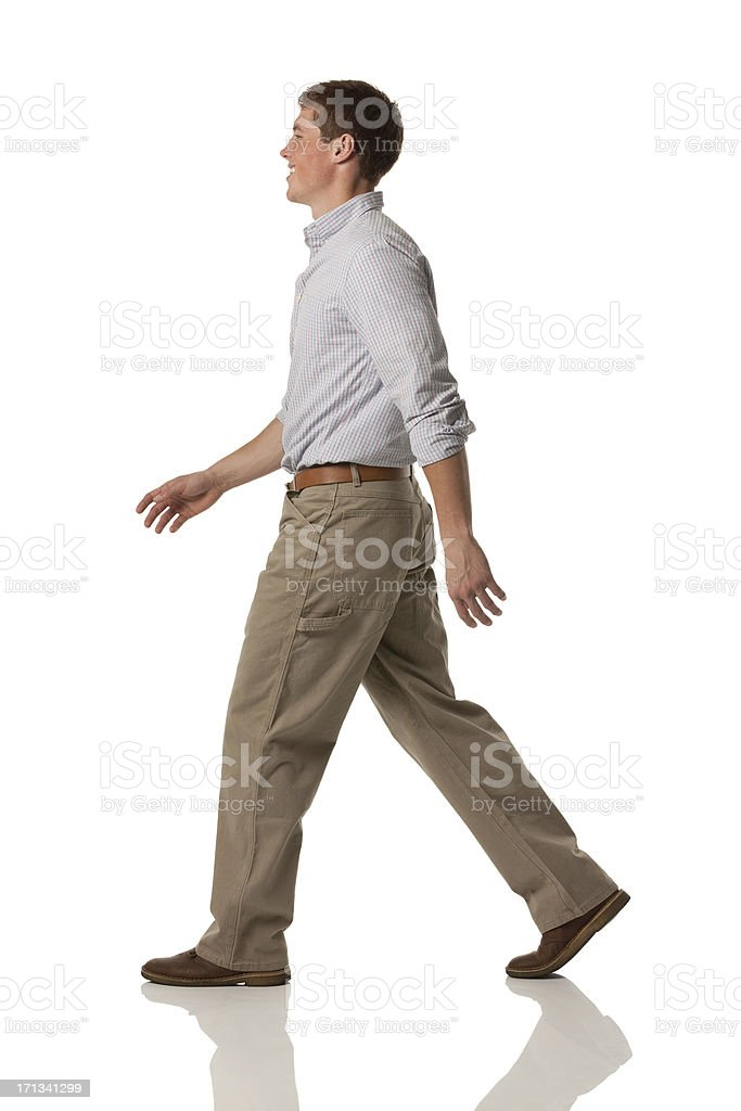 Profile of a happy man walking stock photo