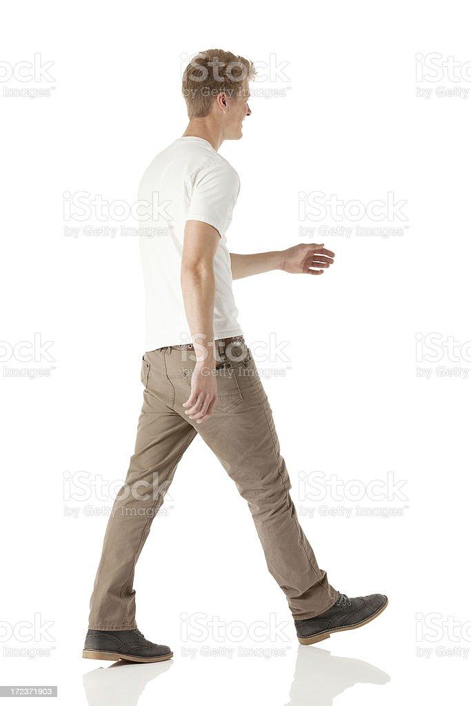 Profile of a happy man walking stock photo