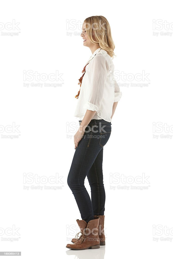 Profile of a happy woman standing stock photo