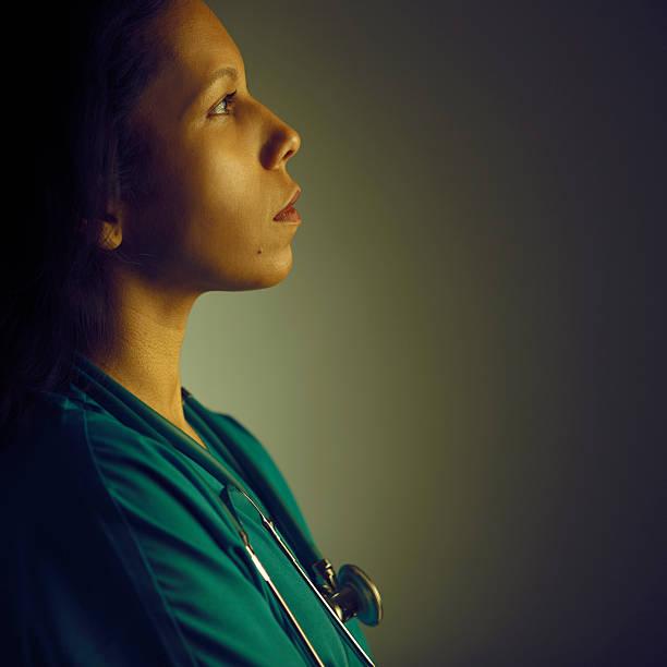 profile of a hopeful doctor stock photo