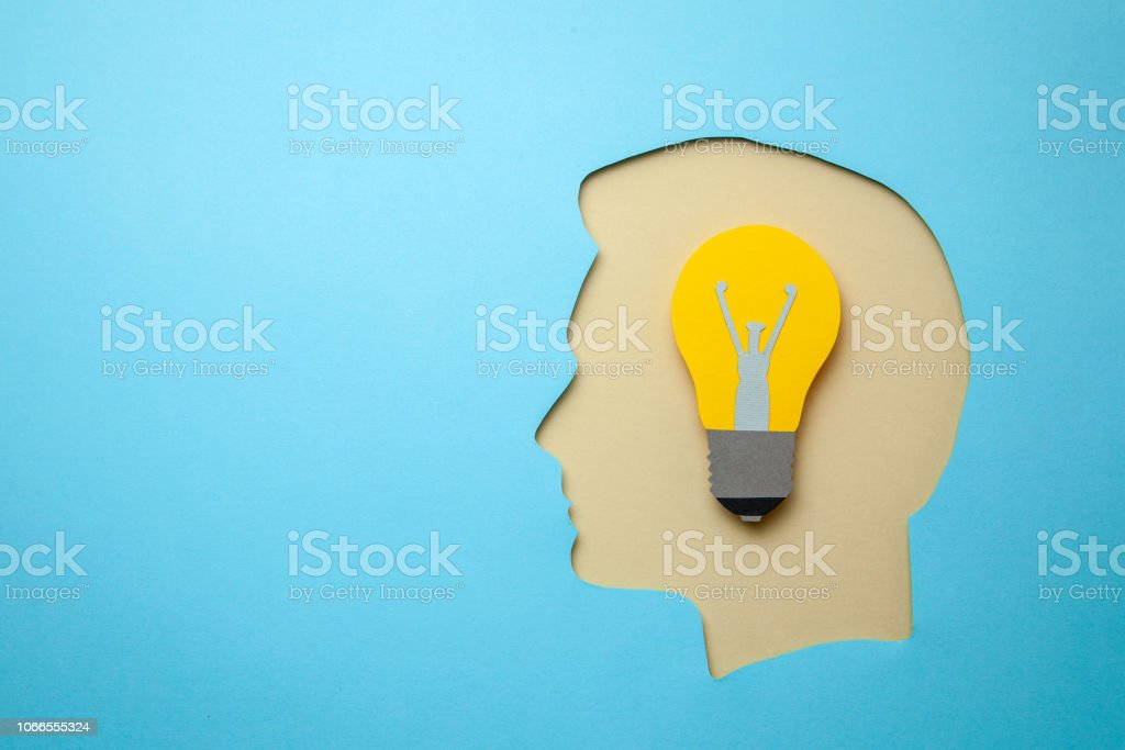Profile of a human head with light bulb as symbol of the idea. Copy space for text stock photo
