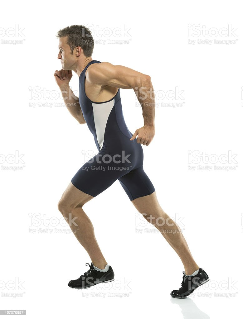 Profile of a male athlete running royalty-free stock photo