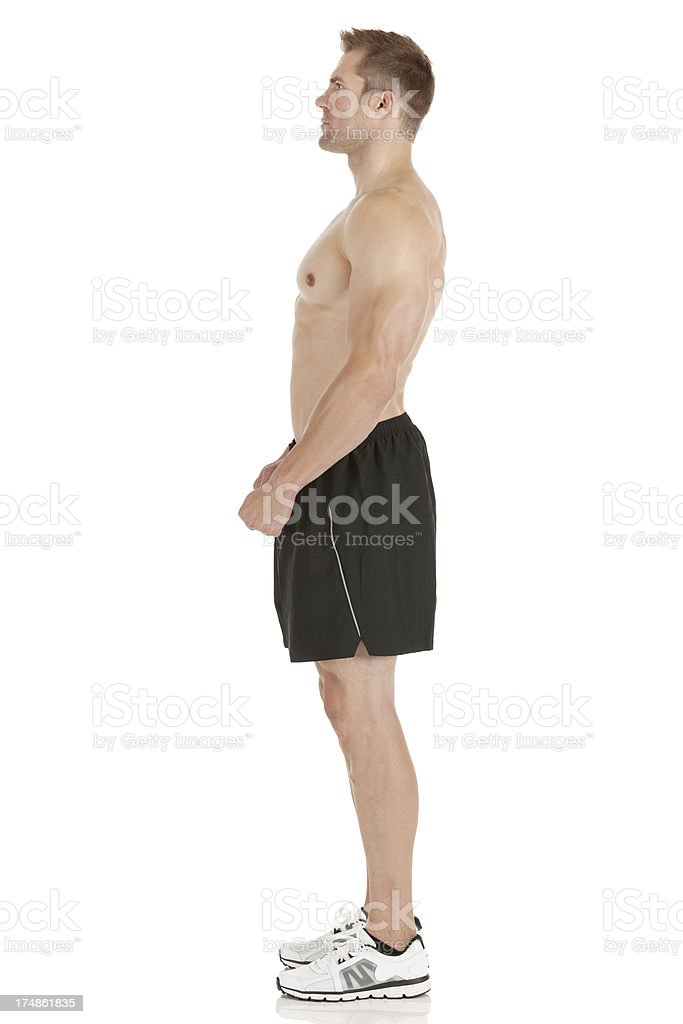 Profile of a muscular man standing royalty-free stock photo